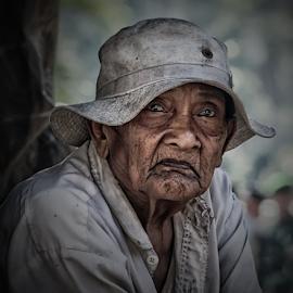 waiting by Bigg Shangkhala - People Portraits of Men ( elder, face, bali, old, men, portrait, man )