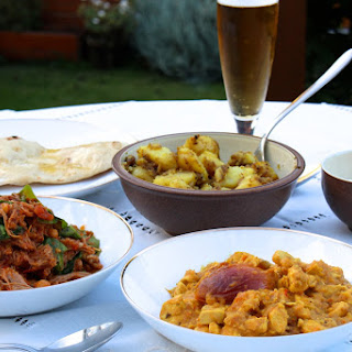 Pulled Lamb and Chickpea Curry and Creamy Chicken and Nectarine Curry served with Bombay Potatoes and Buttery Garlic Naan