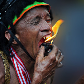 eat fire by Arief Setiawan - People Portraits of Men