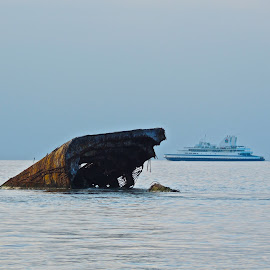 Ferrying Past the Hulk by T. Rick Jones - Transportation Boats ( atlantus, sunken, ferry, boat, new jersey )