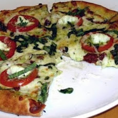 Pesto Pizza With Sliced Tomatoes