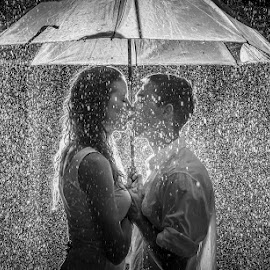 Love in the rain by Charlotte Hellings - People Couples ( love, blackandwhite, lovers, fineart, black and white, fine art, raindrops, beauty, people, rain, Wedding, Weddings, Marriage )