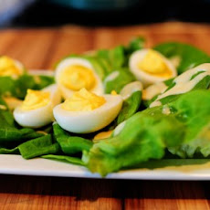 Deviled Eggs on a Nest of Butter Lettuce with Honey Mustard Dressing
