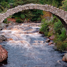 Carrbridge by David Hajes - Buildings & Architecture Bridges & Suspended Structures ( scotland, europe, art of light, fine art, architecture, landscape, storm, landmark, hajek, hajes.org, trees, david, bridge, carrbridge, rocks, wild water, culture, hajes, river, herritage )
