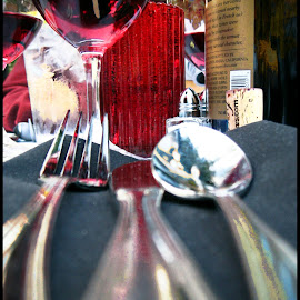 bottle of wine by Leslie Hunziker - Food & Drink Alcohol & Drinks ( wine, silverware, table )