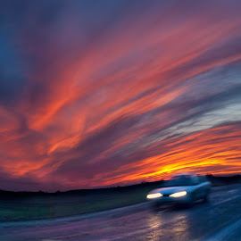 Car on the highway by Nina Lishchuk - Transportation Automobiles ( car, panning, hills, highway, speed, automobile, sunset, cloudscape, cloud, road, evening )