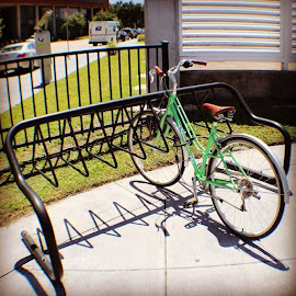 # by Lori Broussard - Instagram & Mobile Instagram ( bicycle, park, green, usps, andyourworthit, bikelock, colors, cable, canon, cement, clouds, cruiser, canont3i, canonrebel, myphotography, everydayobjects, htown, bayoucity, lperiodbperiod, lockyourbike, sobrietyisfun )