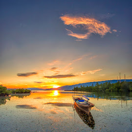Sunrise and a boat  by Ipin Utoyo - Landscapes Sunsets & Sunrises