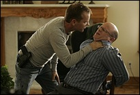 24:  Jack (Kiefer Sutherland, L) tries to get information from his brother Graham (Paul McCrane, R) in the