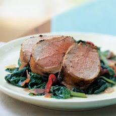 Pork Tenderloin on a Bed of Spinach, Piquillo Peppers, and Prosciutto