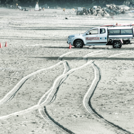 Tracks by Petra Bensted - News & Events Health ( sand, tyre tracks, gold coast, beach, tracks, surf life saving )