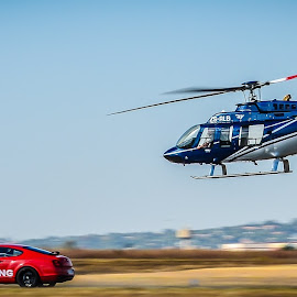 Land air chase by Alexius van der Westhuizen - Transportation Helicopters ( bell, speed, breitling, chase, airstrip, bentley,  )