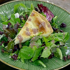 Garlic and Rosemary Goat Cheese Tart Served with Spring Greens and Black Olive Vinaigrette