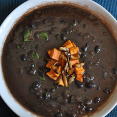 Black Bean Soup Topped with Lime-Toasted Pepitas and Roasted Sweet Potatoes