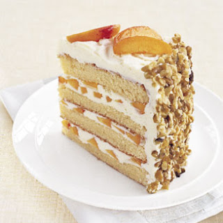 White Chocolate Layer Cake with Apricot Filling and White Chocolate Buttercream.