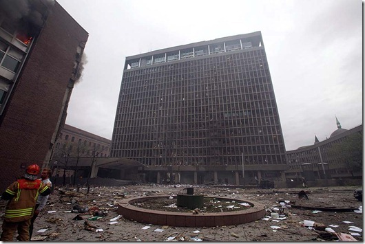 A view of the damaged Norway's Prime Minister's Office building taken after an explosion in Norway's capital Oslo on July 22, 2011. At least one person was killed by the powerful explosion which ripped through government and media buildings.     AFP PHOTO / SCANPIX / Berit Roald<br />NORWAY OUT (Photo credit should read HOLM MORTEN/AFP/Getty Images)