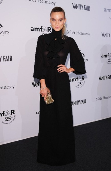 Fiammetta Cicogna in FENDI Fall-Winter 2011-2012 - long black dress with jabot ballon sleeves and FENDI mini Baguette.