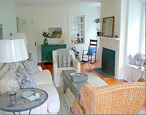 Today: The Living Room Is Bright And Cheery With White Slipcovers, And Blue  And White Striped Fabrics. The Room Is Filled With American Antiques.
