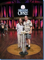 9376 Nashville, Tennessee - Grand Ole Opry - Opry House Backstage Pass Tour - Karen & Bill on the six-foot circle from the stage of the Opry's famous former home, the Ryman Auditorium