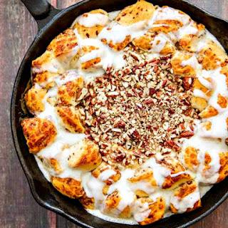 Skillet Cinnamon Rolls with Salted Caramel & Pecan Cream Cheese Dip.