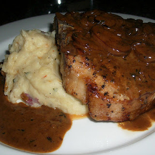 Grilled Pork Chop with Brandy Mushroom Sauce.