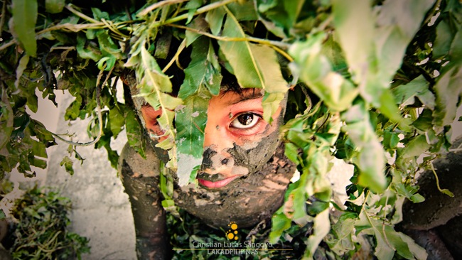 A Kid in Leaves and Mud Costume at Moriones Festival