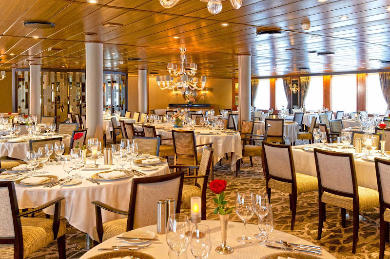 Wind Spirit's main dining room, AmphorA, is located on deck 3, accented with warm wood finishes and luxurious booths, with many tables for two and four passengers.