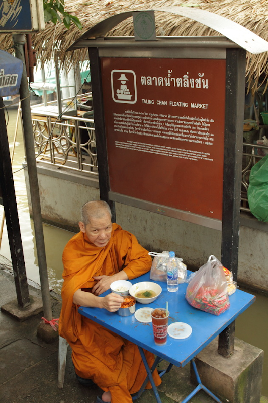 Monk at the entrance of Taling Chan Floating Market, Bangkok