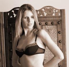 Woman posing in her lingerie