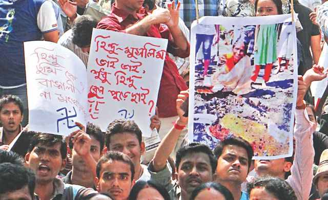 People of the Hindu community demonstrate in front of Chittagong Press Club yesterday against the recent vandalism and torching of Hindu homes and temples across the country. They vowed to resist such attacks in future. Photo: Star
