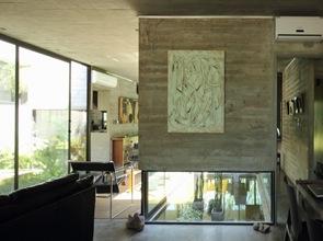 moderna casa de hormigón en interior ba bak arquitectos