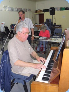 Jim Nicholson the Club Treasurer, accompanying (on piano) Len Hancy on vocals