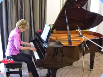 Denise Gunson playing the Yamaha C3 grand piano