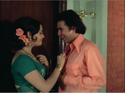 Mumtaz tugs on Rajesh's chest hair