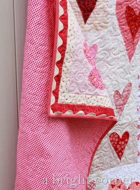 Friendship Heart quilt with cute jumbo ric rac on the binding