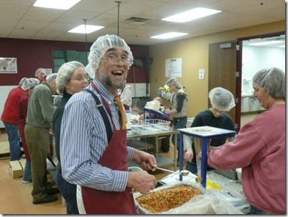 Thomas Malloy, volunteering at Feed My Starving Children