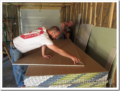 Jay cutting sheetrock for the Owen Workshop Petticoat Junktion