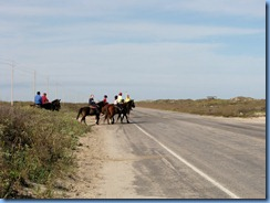 6025 Texas, South Padre Island - horseback riders crossing Padre Blvd