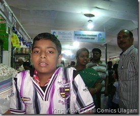CBF Day 13 Photo 33 Stall No 372 This family is from Sivakasi Buying comics in Chennai