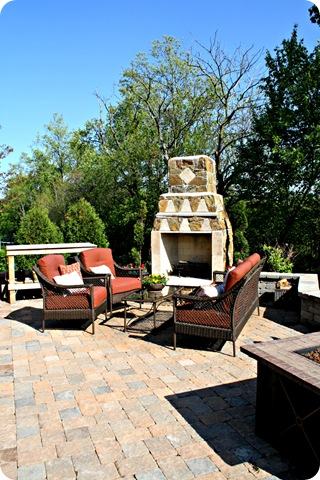 stone patio and outdoor fireplace
