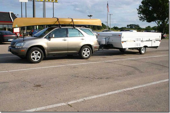 car canoe and camper