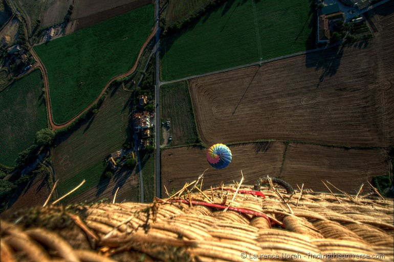 Looking down from a balloon to another balloon