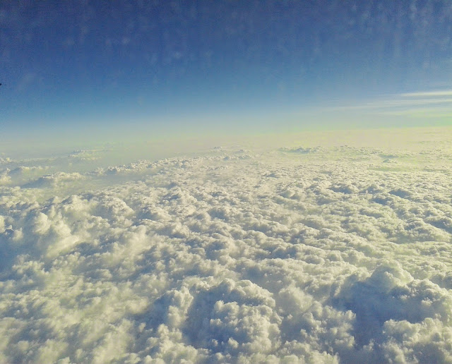 Clouds seen from plane. Photo for First rain (Poem no.3) by Alex O' Connor