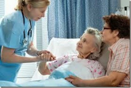 155932-425x282-Hospice-nurse-with-patient-and-family-member