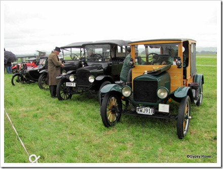 "Beautifully restored cars and motorcycle of the early 1900's including a pair of Ford model ""T""s"