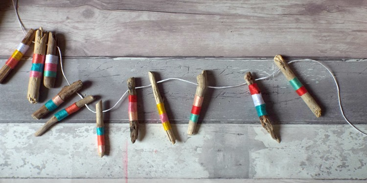 driftwood strung in a colourful garland