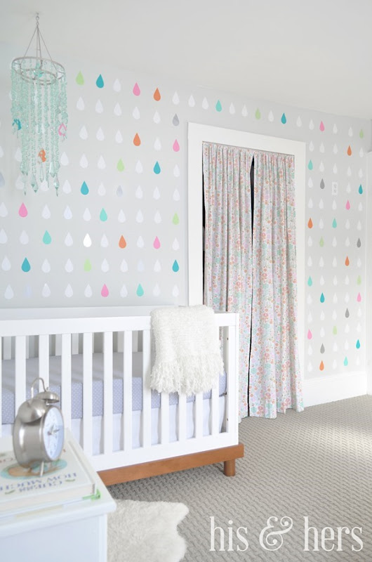 Make your own colorful vinyl raindrop accent wall! Adorable, easy, and cheap.