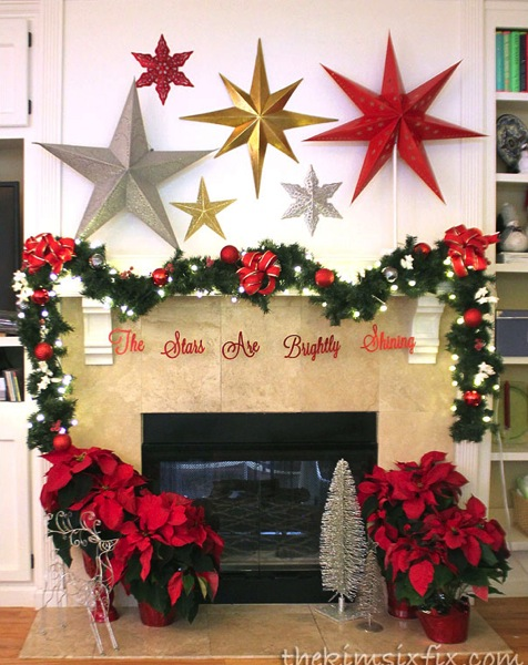 Christmas mantel with stars in gold silver and red. BEAUTIFUL!