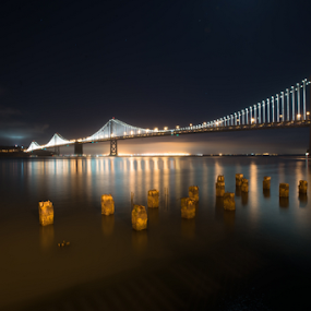 San Francisco Bay Bridge at night by Kathy Dee - Buildings & Architecture Bridges & Suspended Structures ( water, reflection, california, attractions, ocean, tourism, bay bridge, travel, bay area, destination, lights, night, bridges, san francisco, , city at night, street at night, park at night, nightlife, night life, nighttime in the city )