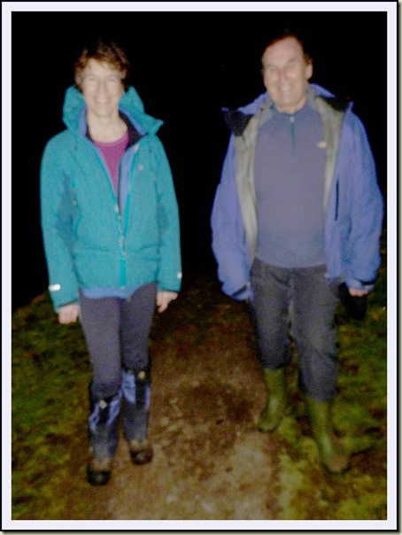 Sue and Andrew rush along the Bridgewater Canal towpath at night
